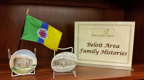 BPL Beloit Families Bookcase & Flag